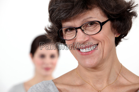 mother stood with daughter in background