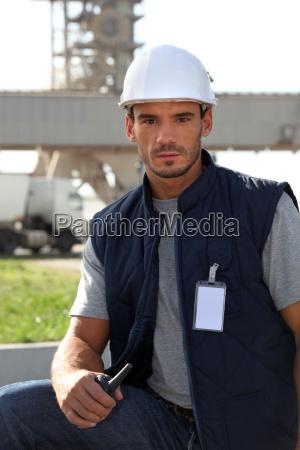 site surveyor holding radio receiver
