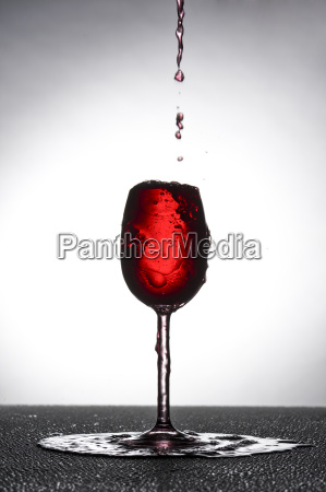 red wine glass in overflowed