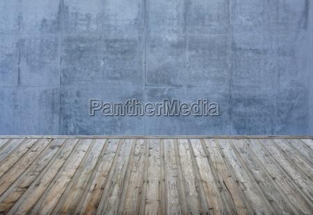 leerer raum steinwand blau grau