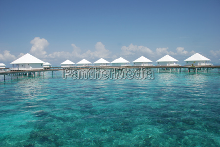 clear turquoise water with water bungalow