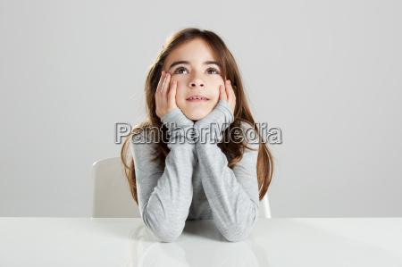 little girl in a desk