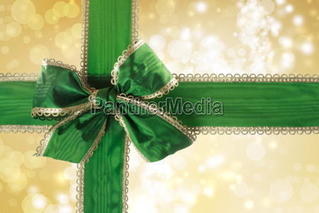 green bow and ribbon with bokeh