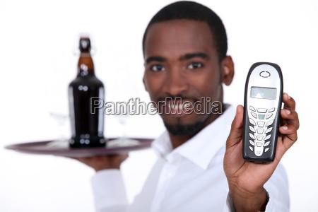 black wine waiter showing a telephone