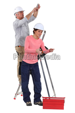 electrician and female apprentice working together