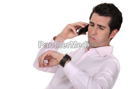 a businessman over the phone looking