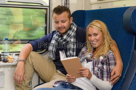 couple traveling by train woman reading