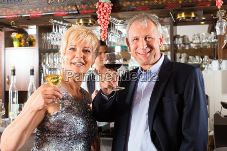 senior couple with glass of wine