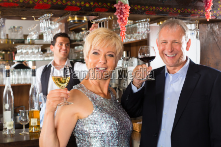 older couple with glass of wine