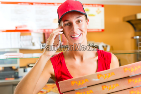 delivery service woman holding pizza