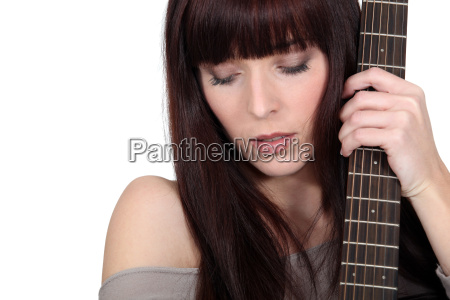 a woman with a guitar