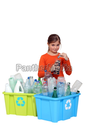 young girl recycling plastic bottles and