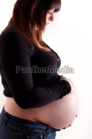 side shot of a pregnant woman
