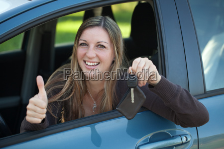 happy female driver with key