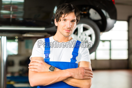 car mechanic in his workshop