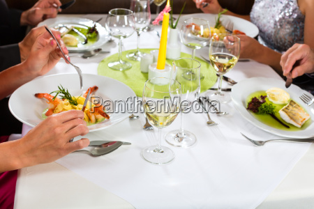 people eat in a restaurant or