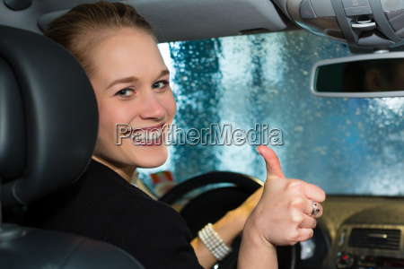young woman driving a car in