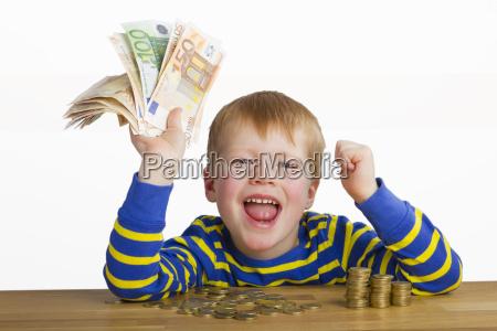 jubilant boy with money
