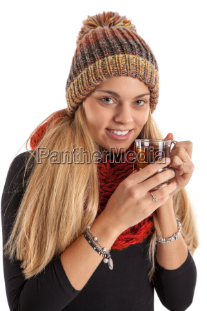 pretty young woman drinks warm tea