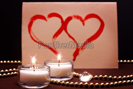 romatic background with two painted hearts