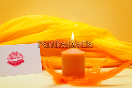 orange background romantic with kissed mouth