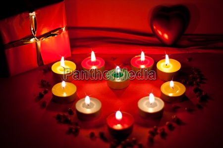 heart of candles giving warm light