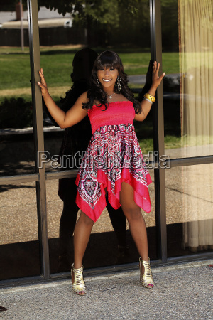 young african american woman outdoors red