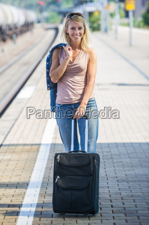 woman with suitcase on the platform