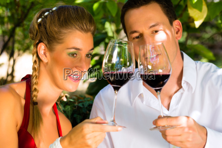 woman and man toasting with wine