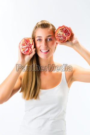 healthy eating woman with pomegranate