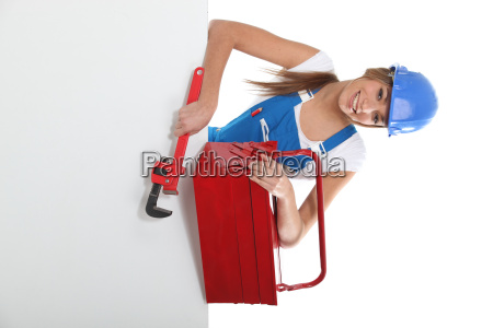 craftswoman holding a spanner and a