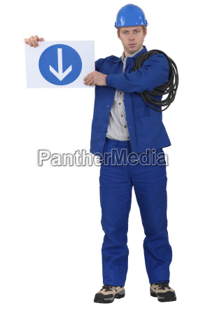 tradesman holding a traffic sign