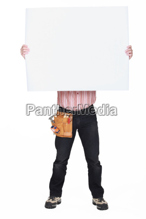 man covering his face with a