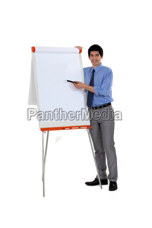 man pointing at flip chart with
