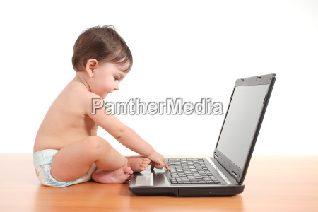 baby typing on a laptop computer