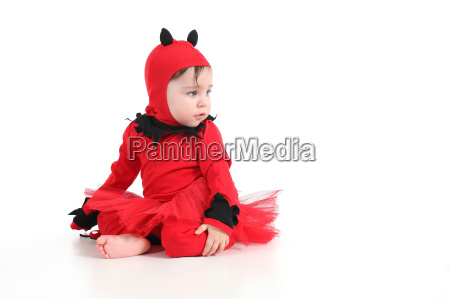 baby with a red demon disguise