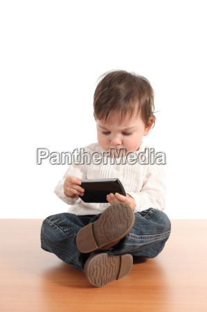 casual baby with a mobile phone