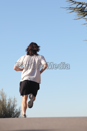 back view of a man running