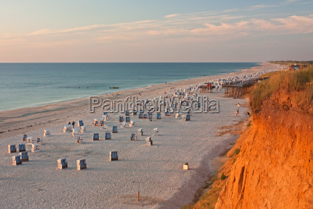 beach with beach chairs on the