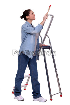 female decorator stood by step ladder