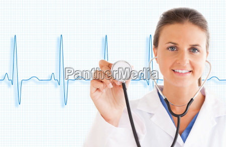doctor holding up stethoscope with blue
