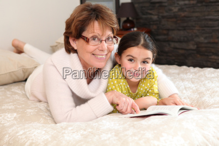 little girl reading a book with
