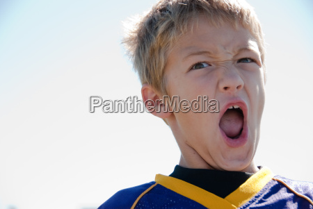 young blonde boy yelling