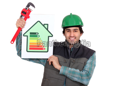 tradesman holding a pipe wrench and