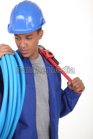 young worker with blue flexible tube