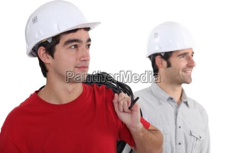 duo of electricians in studio