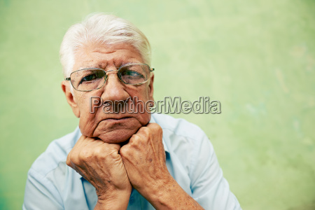 portrait of serious old man looking