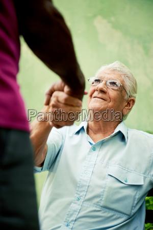 old black and caucasian men meeting