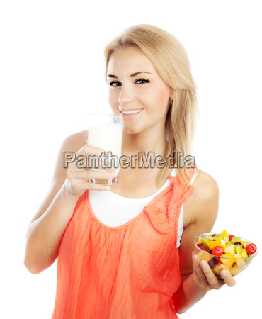 pretty girl eating fruits and drinking