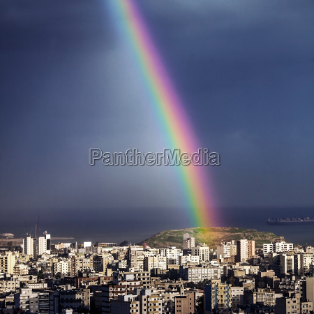 bright rainbow over city